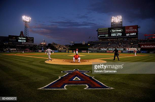 Garrett Richards of the Los Angeles Angels of Anaheim warms up in between first and second innings with rain storm clouds in the background against...