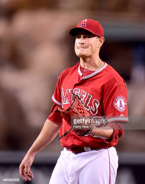 Garrett Richards of the Los Angeles Angels reacts to a Nelson Cruz of the Seattle Mariners solo homerun to take a 10 lead during the first inning at...