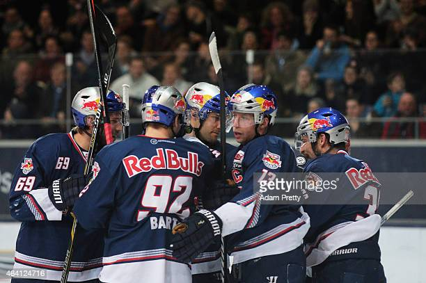 Garrett Roe of EHC Muenchen and team mates celebrate a goal during the DEL Ice Hockey match between EHC Muenchen and Eisbaeren Berlin on February 22...