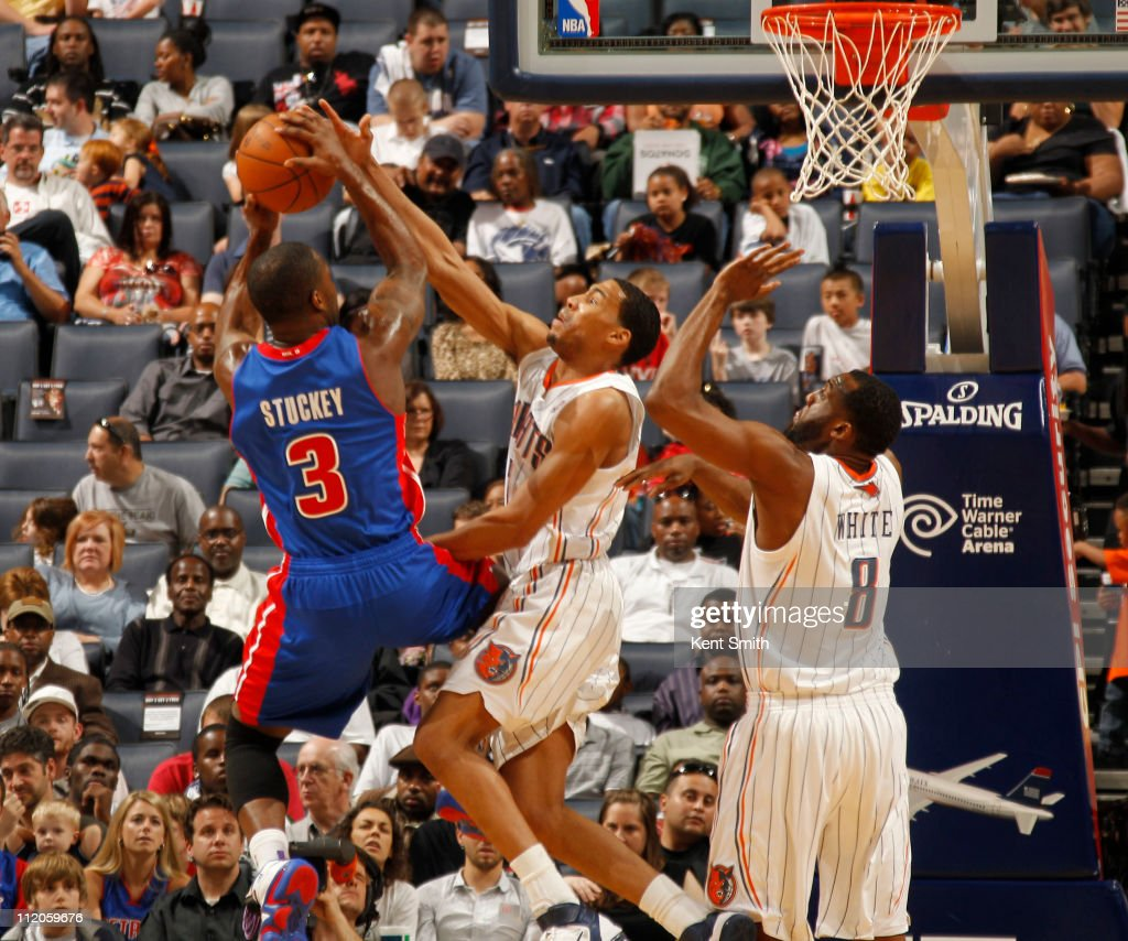 Garrett Temple #41 of the Charlotte Bobcats blocks the shot of <a gi-track='captionPersonalityLinkClicked' href=/galleries/search?phrase=Rodney+Stuckey&family=editorial&specificpeople=4375687 ng-click='$event.stopPropagation()'>Rodney Stuckey</a> #3 of the Detroit Pistons on April 10, 2011 at Time Warner Cable Arena on the practice court in Charlotte, North Carolina.
