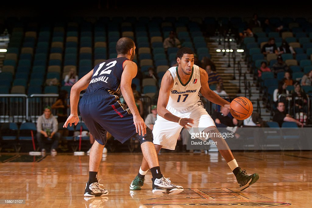 Garrett Temple #17 of the Reno Bighorns brings the ball up court guarded by Kendall Marshall #12 of the Bakersfield Jam on December 7, 2012 at the Reno Events Center in Reno, Nev..