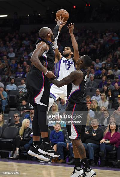Garrett Temple of the Sacramento Kings shoots over Marreese Speights of the Los Angeles Clippers during an NBA basketball game at Golden 1 Center on...