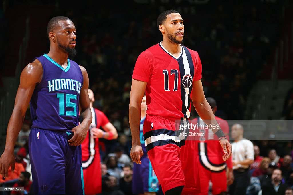 Garrett Temple of the Washington Wizards and Kemba Walker of the Charlotte Hornets look on during the game on December 19 2015 at Verizon Center in...