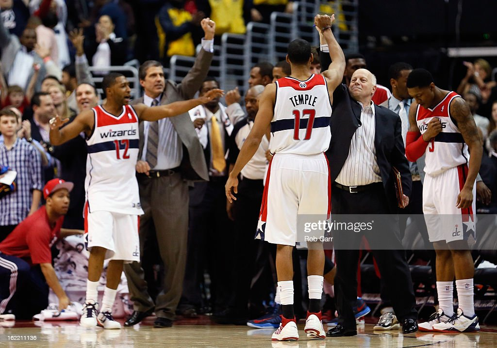 Garrett Temple #17 of the Washington Wizards and members of the team celebrate during the closing moments of their win over the Oklahoma City Thunder at Verizon Center on January 7, 2013 in Washington, DC.