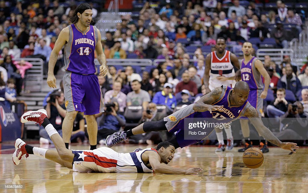 <a gi-track='captionPersonalityLinkClicked' href=/galleries/search?phrase=Garrett+Temple&family=editorial&specificpeople=709398 ng-click='$event.stopPropagation()'>Garrett Temple</a> #17 of the Washington Wizards and <a gi-track='captionPersonalityLinkClicked' href=/galleries/search?phrase=P.J.+Tucker&family=editorial&specificpeople=227316 ng-click='$event.stopPropagation()'>P.J. Tucker</a> #17 of the Phoenix Suns go after a loose ball during the first half at Verizon Center on March 16, 2013 in Washington, DC.