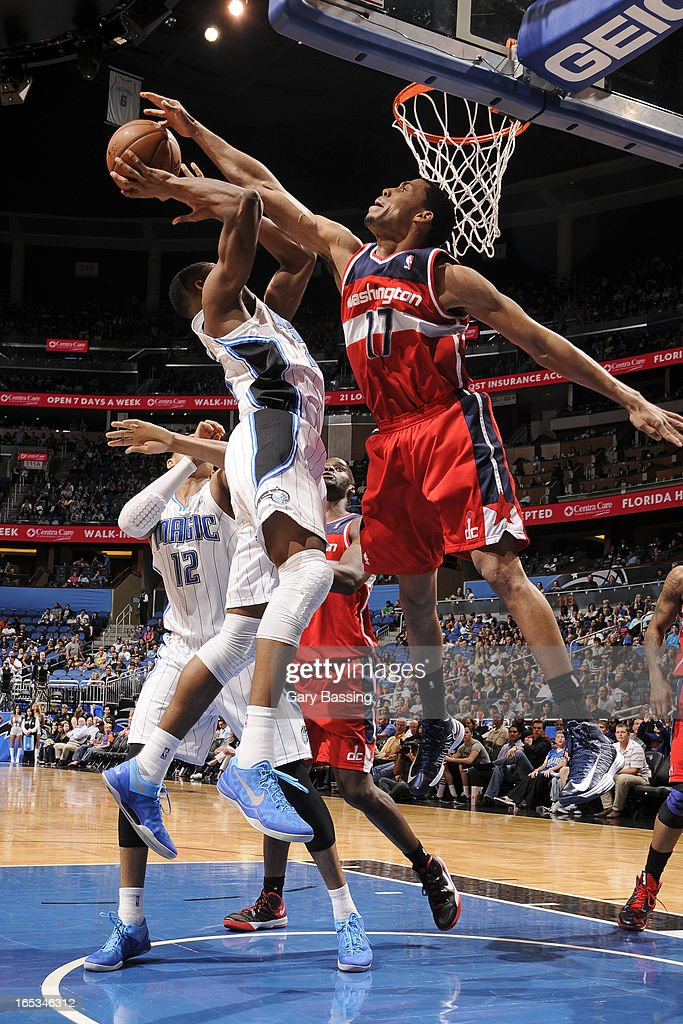 <a gi-track='captionPersonalityLinkClicked' href=/galleries/search?phrase=Garrett+Temple&family=editorial&specificpeople=709398 ng-click='$event.stopPropagation()'>Garrett Temple</a> #17 of the Washington Wizards blocks the shot of an Orlando Magic player on March 29, 2013 at Amway Center in Orlando, Florida.