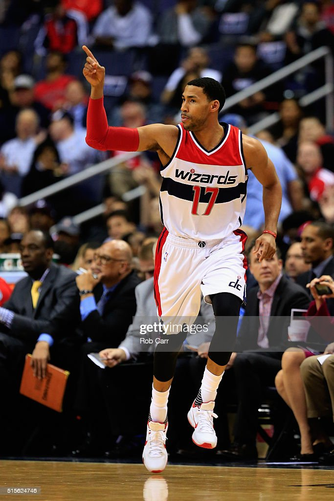 Garrett Temple of the Washington Wizards celebrates after hitting a three pointer against the Detroit Pistons in the first half at Verizon Center on...