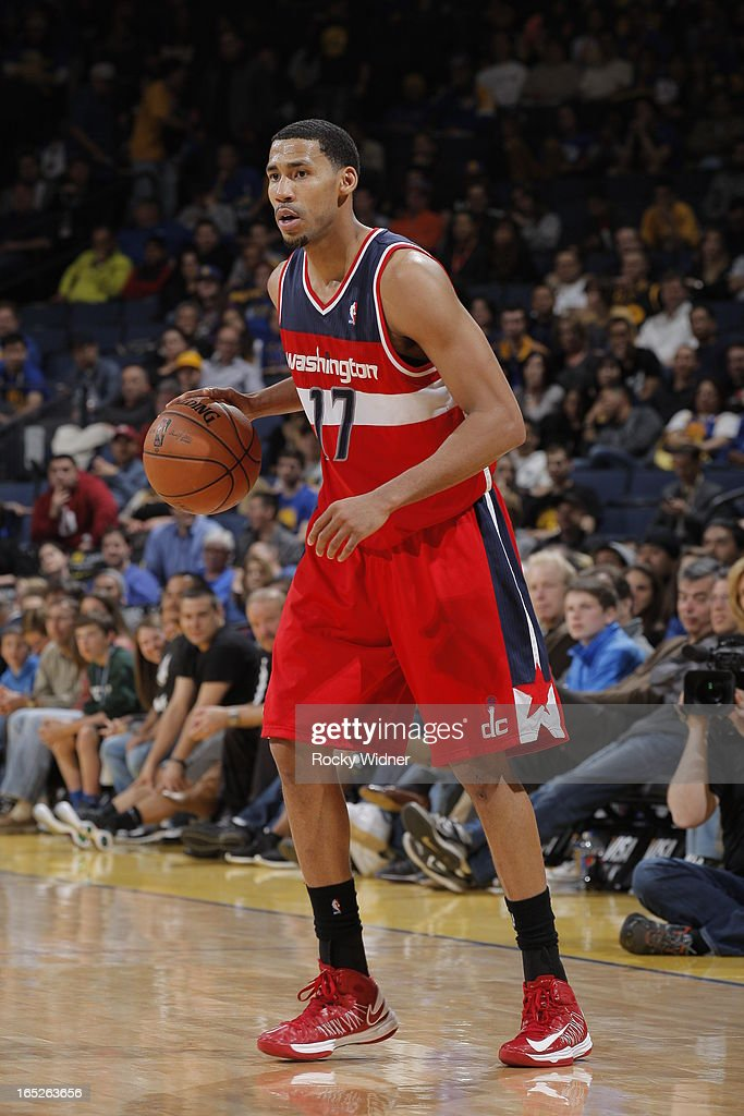 <a gi-track='captionPersonalityLinkClicked' href=/galleries/search?phrase=Garrett+Temple&family=editorial&specificpeople=709398 ng-click='$event.stopPropagation()'>Garrett Temple</a> #17 of the Washington Wizards dribbles against the Golden State Warriors on March 23, 2013 at Oracle Arena in Oakland, California.