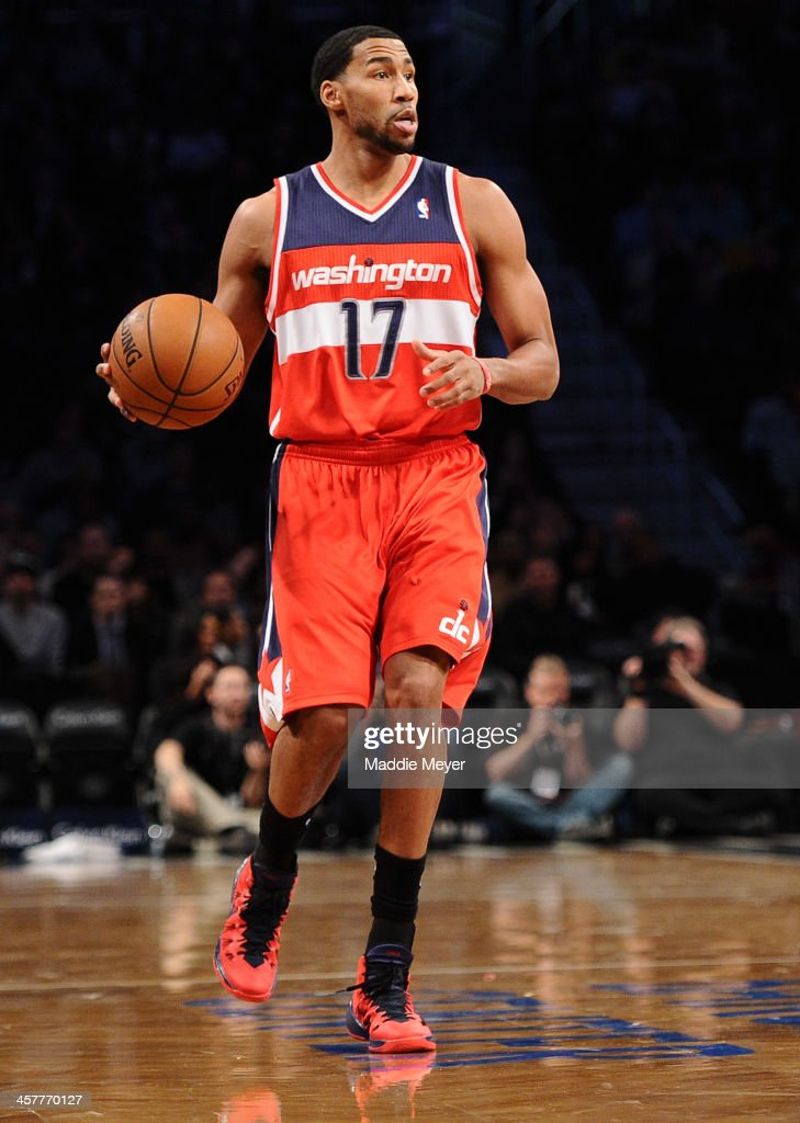 Garrett Temple of the Washington Wizards dribbles against the Brooklyn Nets at Barclays Center on December 18 2013 in the Brooklyn borough of New...