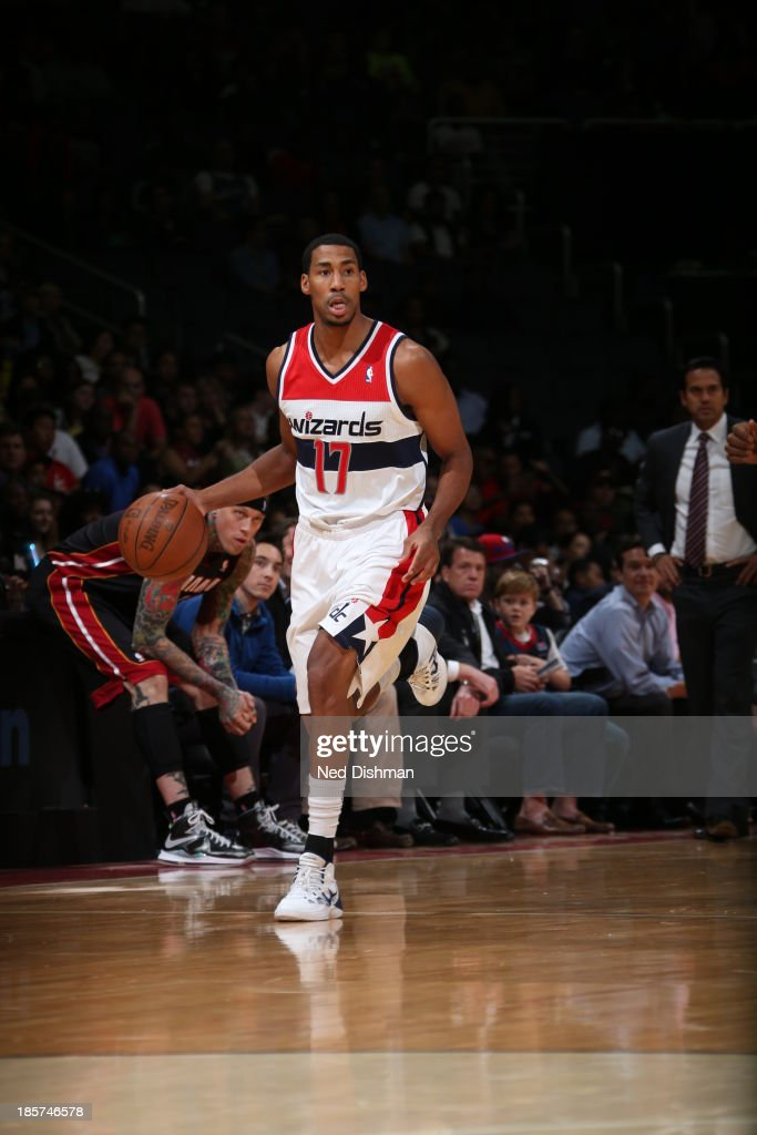 <a gi-track='captionPersonalityLinkClicked' href=/galleries/search?phrase=Garrett+Temple&family=editorial&specificpeople=709398 ng-click='$event.stopPropagation()'>Garrett Temple</a> #17 of the Washington Wizards dribbles up the court against the Miami Heat during the pre-season game at the Verizon Center on October 15, 2013 in Washington, DC.