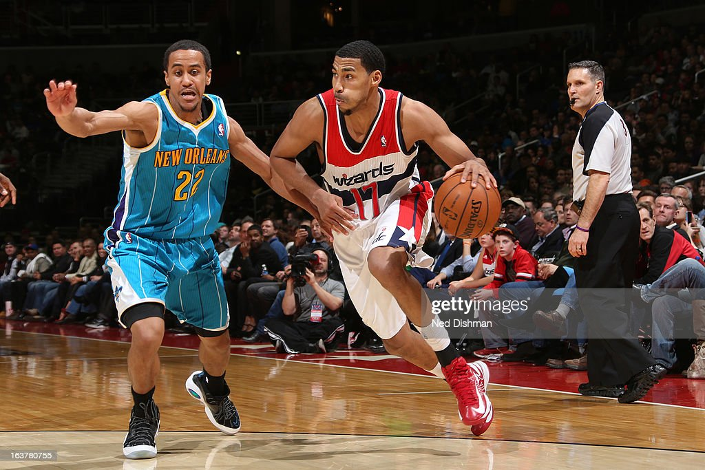 <a gi-track='captionPersonalityLinkClicked' href=/galleries/search?phrase=Garrett+Temple&family=editorial&specificpeople=709398 ng-click='$event.stopPropagation()'>Garrett Temple</a> #17 of the Washington Wizards drives against Brian Roberts #22 of the New Orleans Hornets during the game at the Verizon Center on March 15, 2013 in Washington, DC.