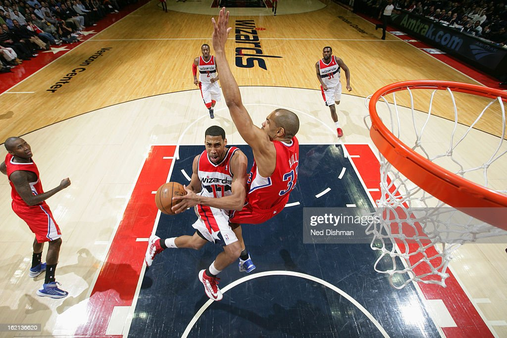 <a gi-track='captionPersonalityLinkClicked' href=/galleries/search?phrase=Garrett+Temple&family=editorial&specificpeople=709398 ng-click='$event.stopPropagation()'>Garrett Temple</a> #17 of the Washington Wizards drives to the basket against <a gi-track='captionPersonalityLinkClicked' href=/galleries/search?phrase=Grant+Hill+-+Basketball+Player&family=editorial&specificpeople=201658 ng-click='$event.stopPropagation()'>Grant Hill</a> #33 of the Los Angeles Clippers on February 4, 2013 at the Verizon Center in Washington, DC.