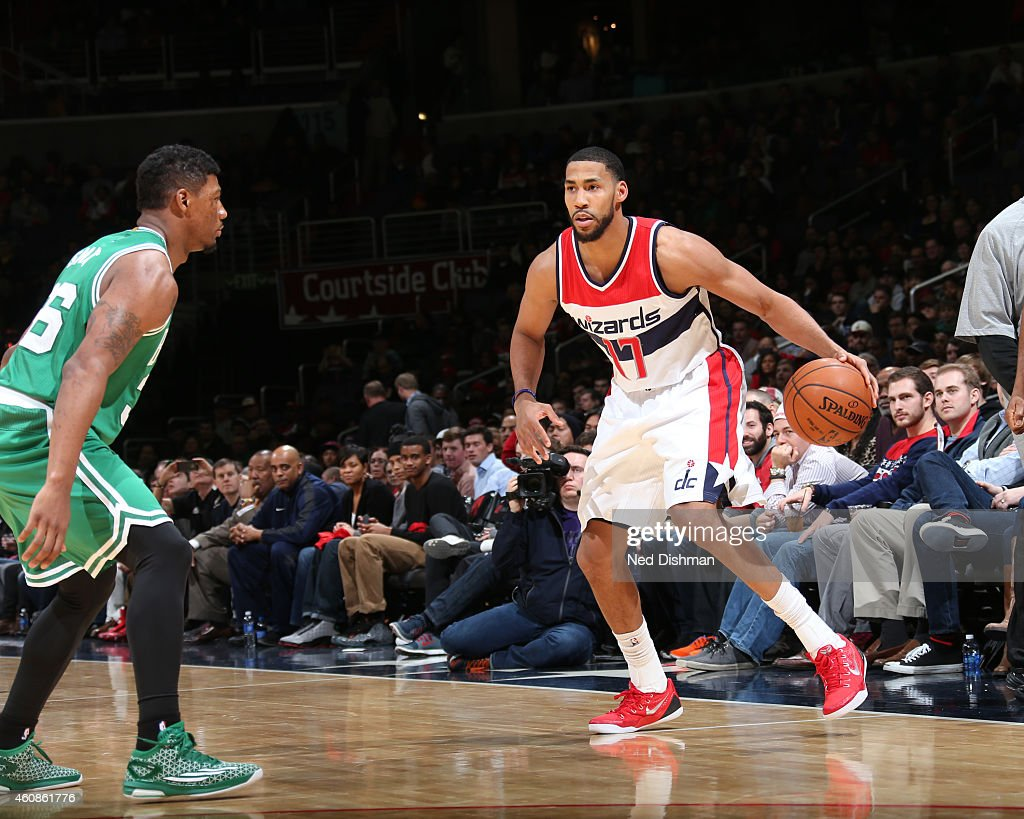Garrett Temple of the Washington Wizards drives to the basket against the Boston Celticsduring the game on December 27 2014 at Verizon Center in...