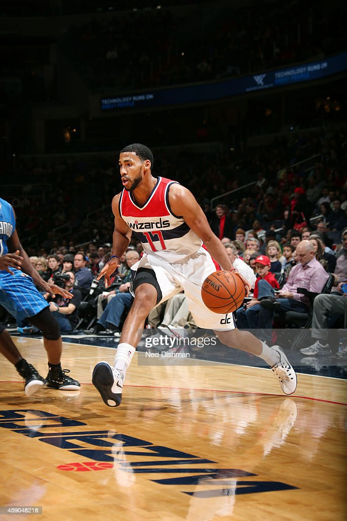 Garrett Temple of the Washington Wizards drives to the basketagainst the Orlando Magic during the game on November 15 2014 at Verizon Center in...