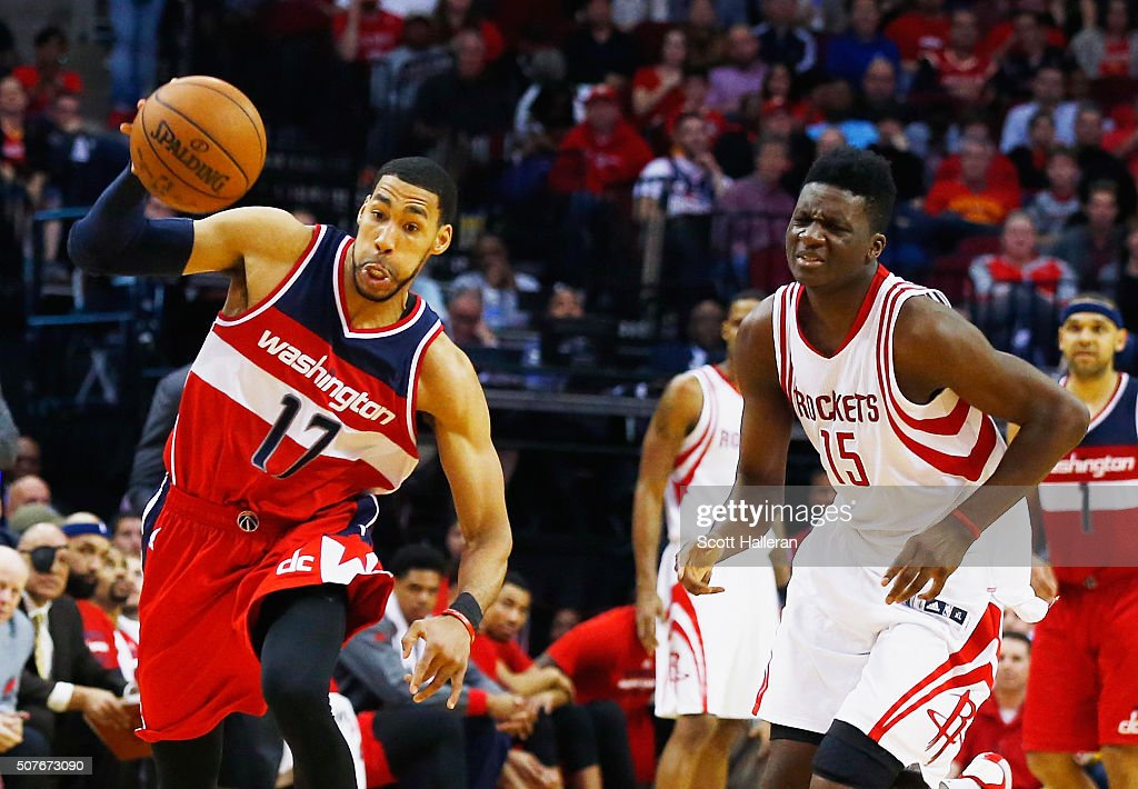 Garrett Temple of the Washington Wizards drives with the basketball in front of Clint Capela of the Houston Rockets during their game at the Toyota...