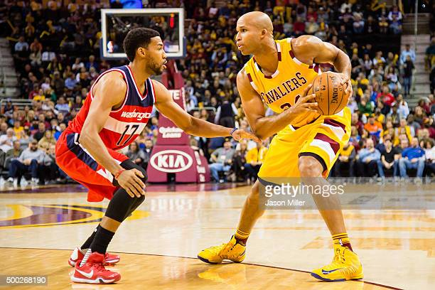 Garrett Temple of the Washington Wizards guards Richard Jefferson of the Cleveland Cavaliers during the first half at Quicken Loans Arena on December...