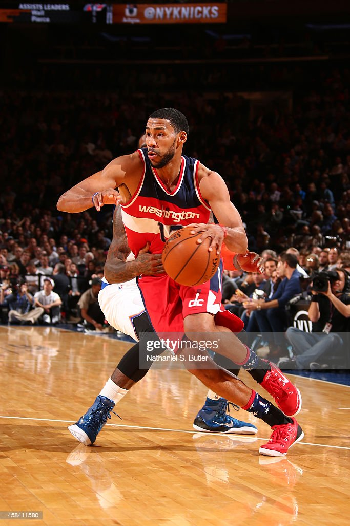 Garrett Temple of the Washington Wizards handles the ball against the New York Knicks during a game at Madison Square Garden in New York City New...