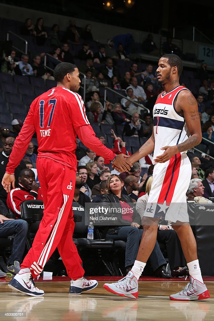 Garrett Temple of the Washington Wizards high fives Trevor Ariza during the game against the Orlando Magic on December 2 2013 in Washington DC at the...