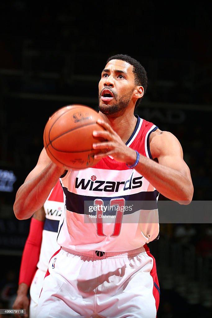 Garrett Temple of the Washington Wizards shoots a free throw against the Toronto Raptors on November 28 2015 at Verizon Center in Washington DC NOTE...