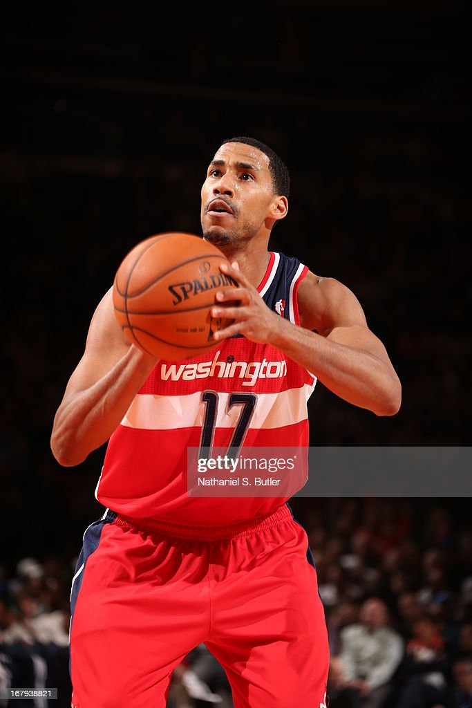 <a gi-track='captionPersonalityLinkClicked' href=/galleries/search?phrase=Garrett+Temple&family=editorial&specificpeople=709398 ng-click='$event.stopPropagation()'>Garrett Temple</a> #17 of the Washington Wizards shoots a free throw during the game against the New York Knicks on April 9, 2013 at Madison Square Garden in New York City.