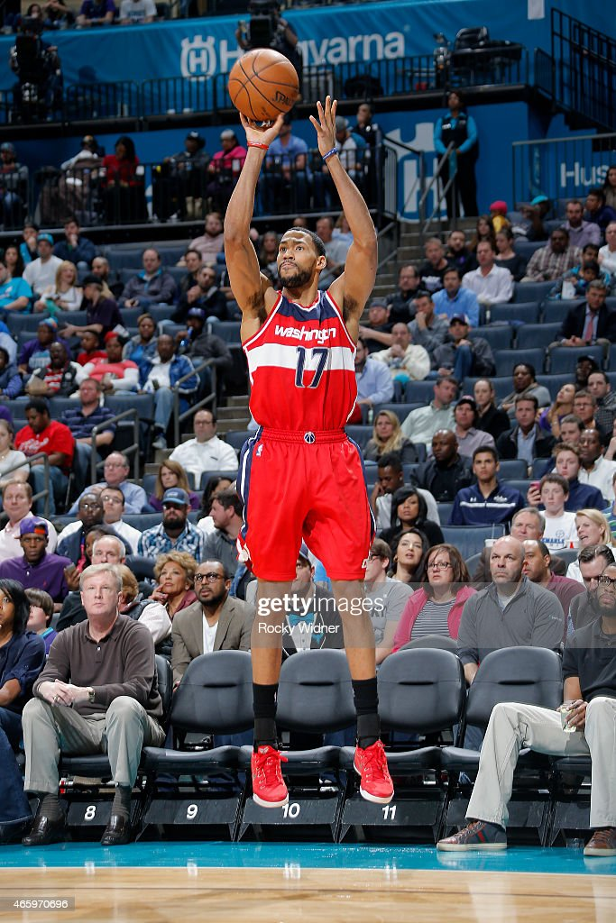 Garrett Temple of the Washington Wizards shoots a three pointer against the Charlotte Hornets on March 9 2015 at Time Warner Cable Arena in Charlotte...