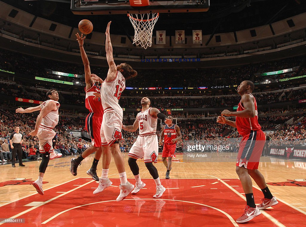 Garrett Temple #17 of the Washington Wizards shoots against Joakim Noah #13 of the Chicago Bulls on December 29, 2012 at the United Center in Chicago, Illinois.