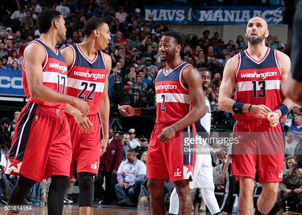 Garrett Temple Otto Porter Jr #22 John Wall and Marcin Gortat of the Washington Wizards huddle up during the game against the Dallas Mavericks on...