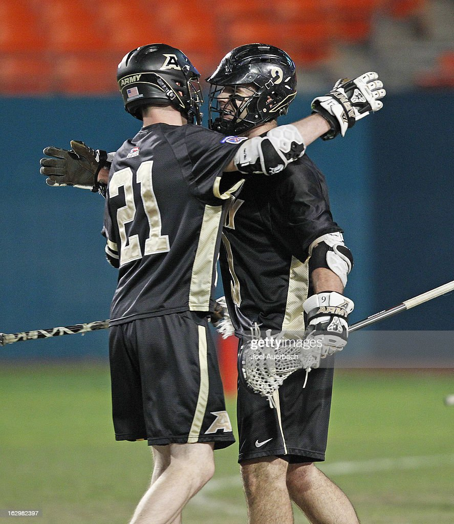 Garrett Thul #9 is congratulated by John Glesener #21 of the Army Black Knights after scoring a goal against the Michigan Wolverines during the 2013 Orange Bowl Lacrosse Classic on March 2, 2013 at SunLife Stadium in Miami Gardens, Florida. Thul scored seven goal in the game and won the MVP trophy. Army defeated Michigan 12-1.