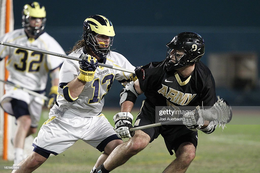 Garrett Thul #9 of the Army Black Knights carries the ball while being defensed by Rob Healy #13 of the Michigan Wolverines during the 2013 Orange Bowl Lacrosse Classic on March 2, 2013 at SunLife Stadium in Miami Gardens, Florida. Army defeated Michigan 12-1.