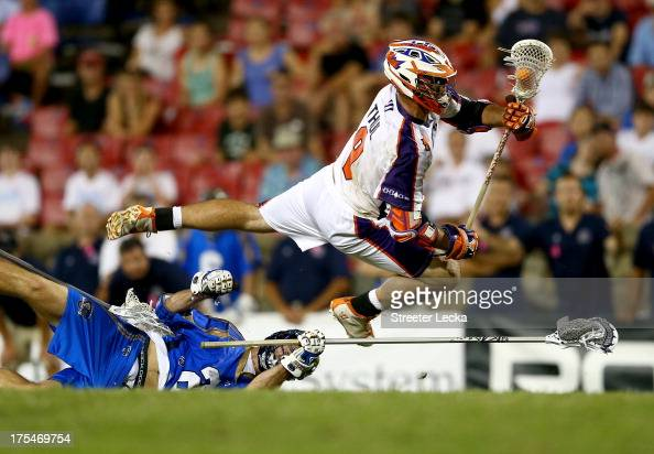 Garrett Thul of the Hamilton Nationals jumps over Ryan Flanagan of the Charlotte Hounds during their game at American Legion Memorial Stadium on...