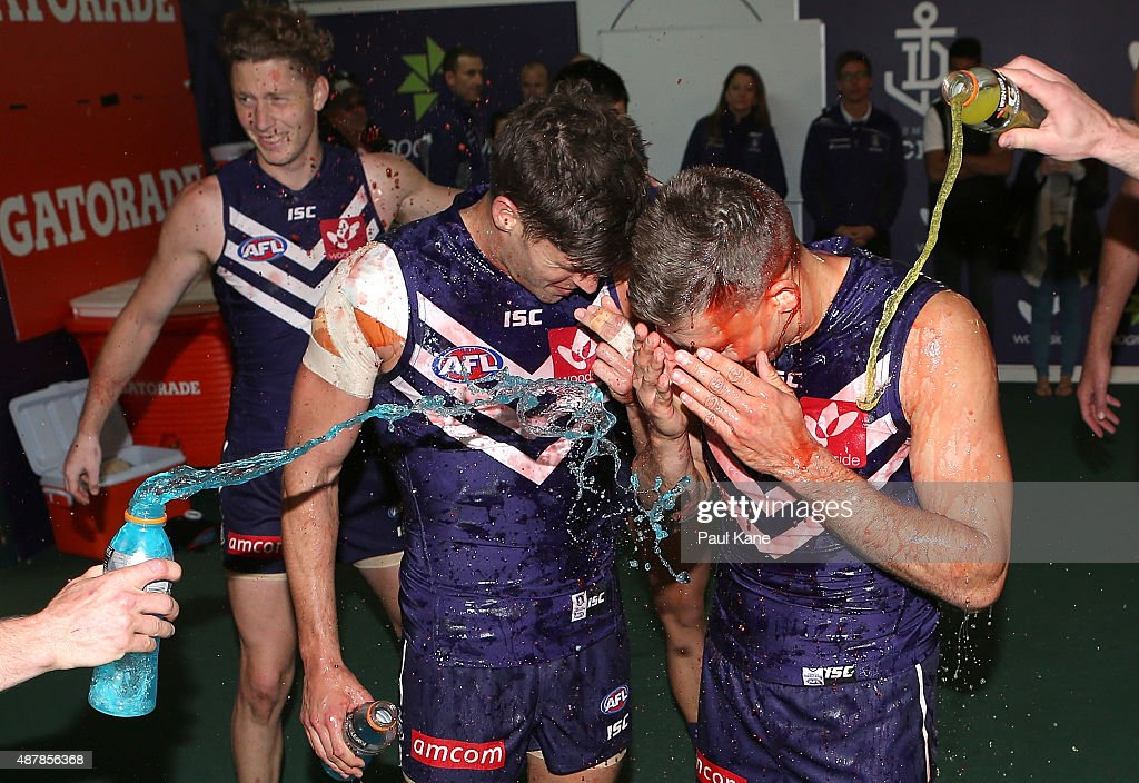 Garrick Ibbotson and Stephen Hill of the Dockers celebrate playing their 150th games and winning the First AFL Qualifying Final match between the...