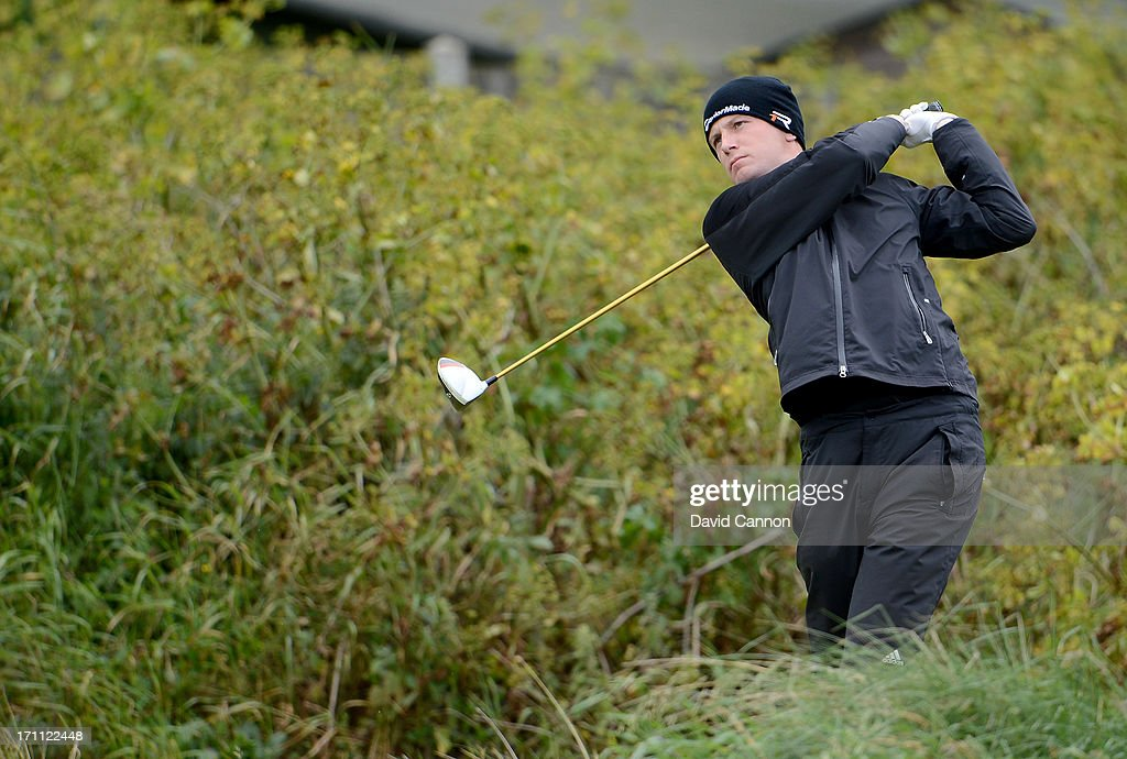 Garrick Poerteous of England plays his tee shot on the second hole during the afternoon round in the final of the 2013 Amateur Championship at Royal Cinque Ports Golf Club on June 22, 2013 in Deal, England.