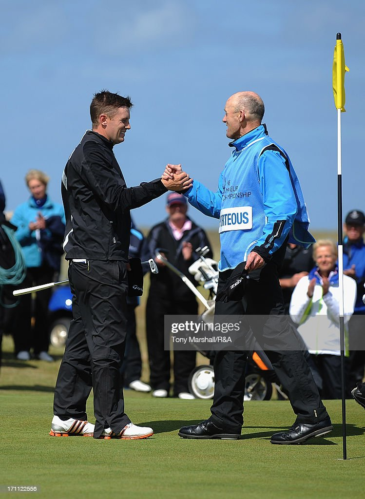Garrick Porteous of Bamburgh Castle is congratulated by his father and caddy John, after winning the final of The Amateur Championship at Royal Cinque Ports Golf Club on the 13th green on June 22, 2013 in Deal, England.