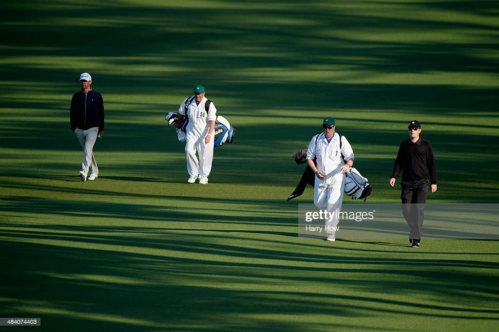 Garrick Porteous of England and Lucas Glover of the United States walk down the fairway on the second hole during the second round of the 2014...