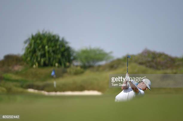 Garrick Porteous of England hits an approach shot on the 3rd hole during day one of the NBO Golf Classic Grand Final at Al Mouj Golf on November 2...