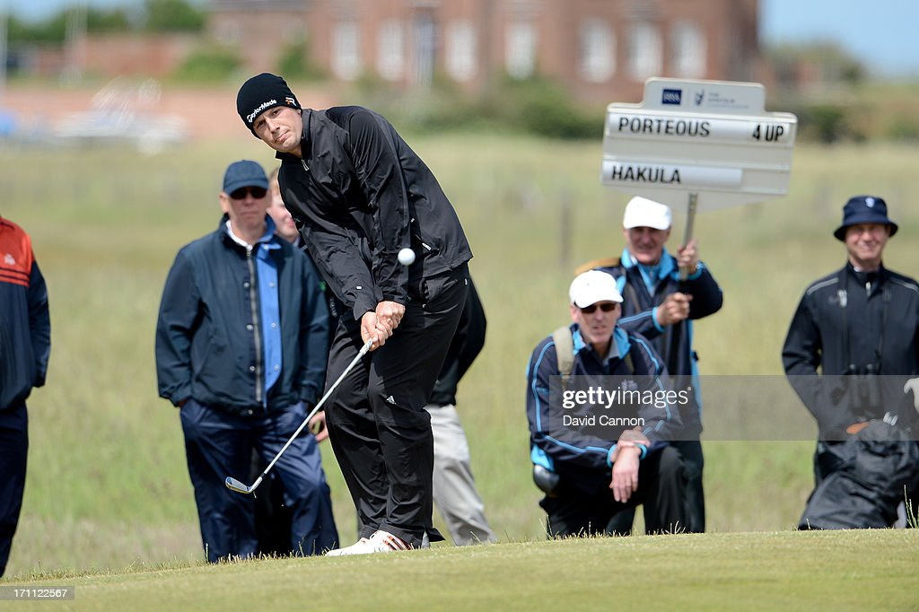 Garrick Porteous of England plays his fourth shot on the 11th hole during the afternoon round in the final of the 2013 Amateur Championship at Royal Cinque Ports Golf Club on June 22, 2013 in Deal, England.
