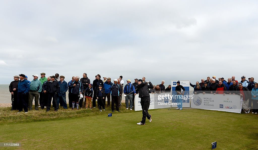 Garrick Porteous of England plays his tee shot on the 7th hole during the afternoon round in the final of the 2013 Amateur Championship at Royal Cinque Ports Golf Club on June 22, 2013 in Deal, England.