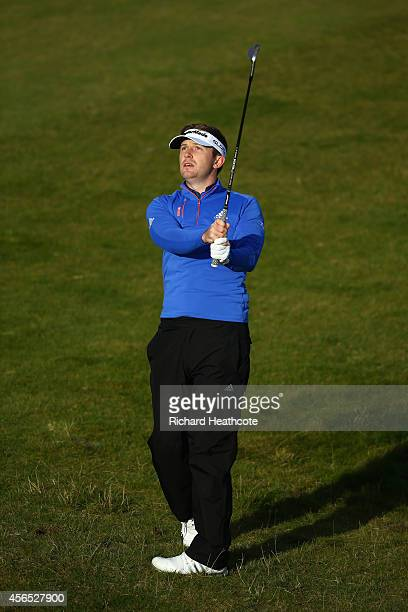 Garrick Porteous of England plays into the 10th green during the first round of the 2014 Alfred Dunhill Links Championship at the Kingsbarns Golf...
