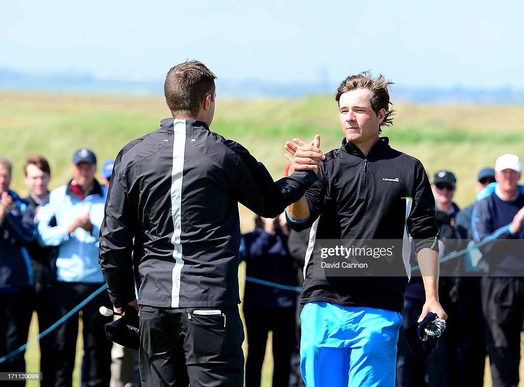 Garrick Porteous of England (L) shakes hands with Toni Hakula of Finland after his 6&5 win over Hakula in the 36 hole final of the 2013 Amateur Championship at Royal Cinque Ports Golf Club on June 22, 2013 in Deal, England.