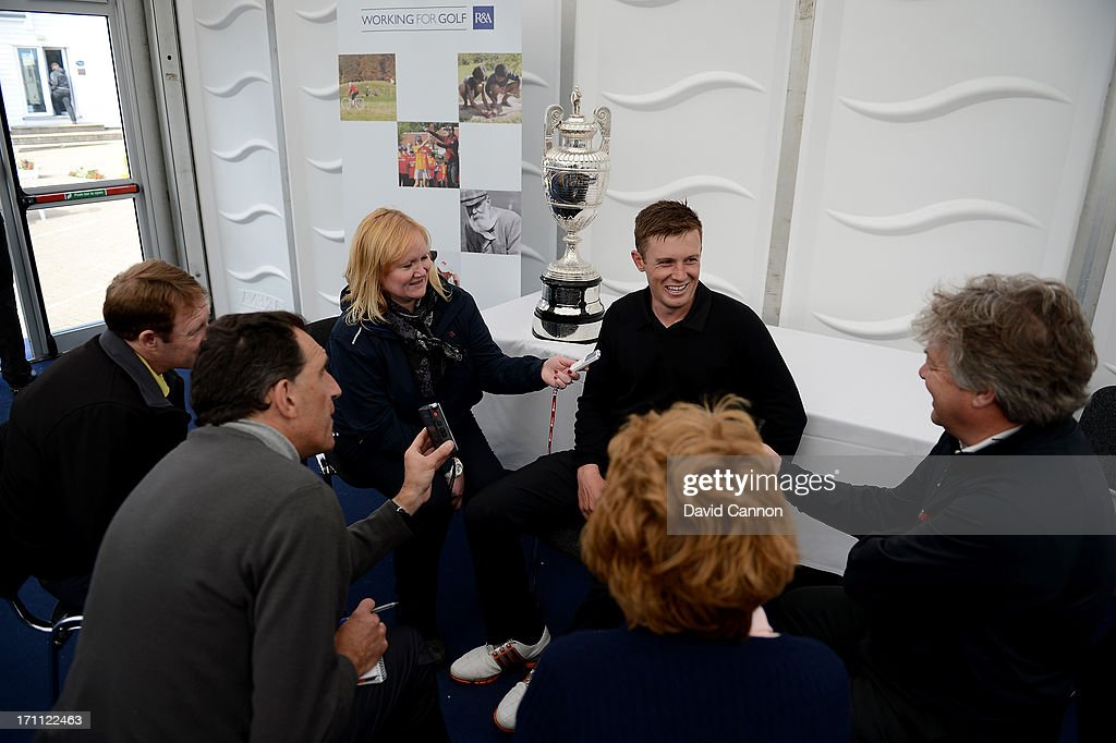 Garrick Porteous of England talking to the media with the Amateur Championship Trophy after his 6&5 victory in the final against Toni Hakula of Finland final of the 2013 Amateur Championship at Royal Cinque Ports Golf Club on June 22, 2013 in Deal, England.