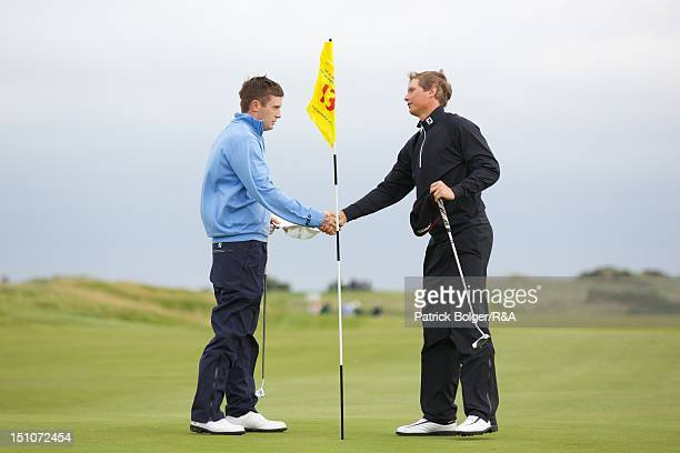 Garrick Porteous of the Great Britain and Ireland team and Tapio Pulkkanen of the Continent of Europe team shake hands on the 13th green after...