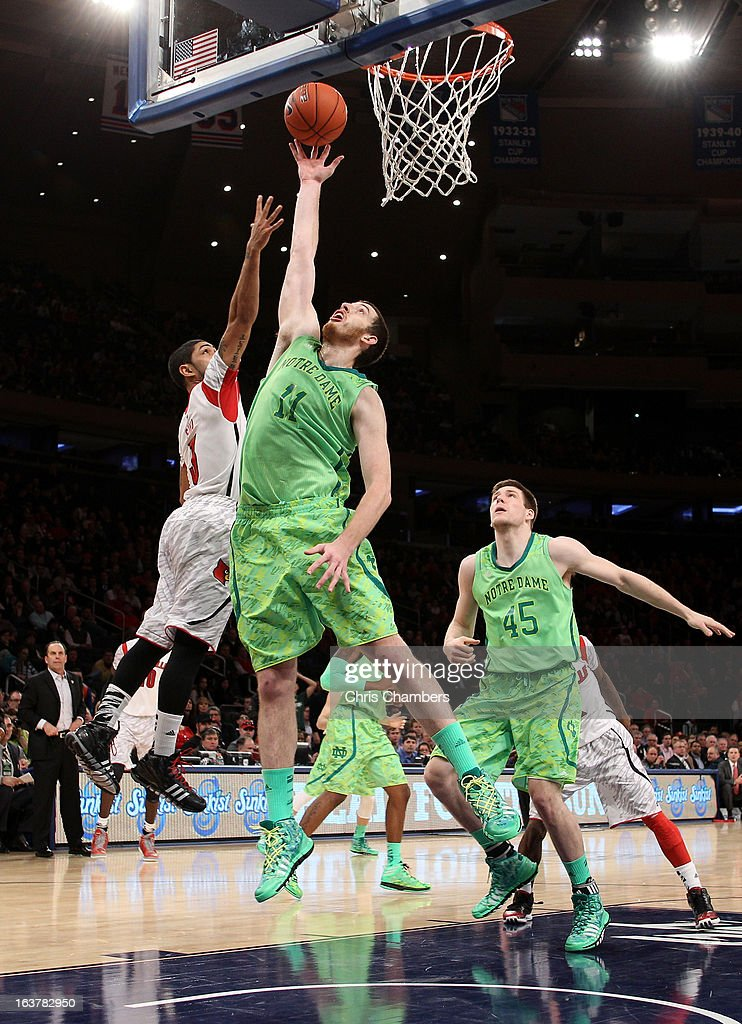 Garrick Sherman #11 of the Notre Dame Fighting Irish attempts a shot in the second half against Peyton Siva #3 of the Louisville Cardinals during the semifinals of the Big East Men's Basketball Tournament at Madison Square Garden on March 15, 2013 in New York City.