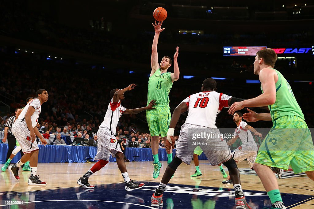 Garrick Sherman #11 of the Notre Dame Fighting Irish attempts a shot against the Louisville Cardinals during the semifinals of the Big East Men's Basketball Tournament at Madison Square Garden on March 15, 2013 in New York City.
