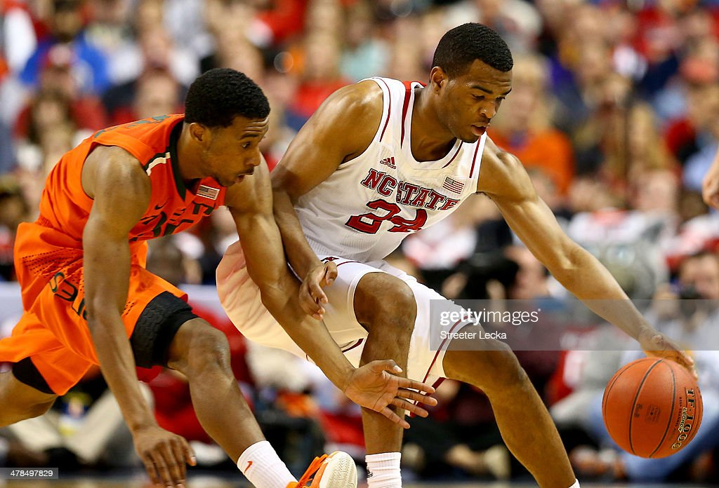 Garrius Adams #25 of the Miami Hurricanes goes after a loose ball against <a gi-track='captionPersonalityLinkClicked' href=/galleries/search?phrase=T.J.+Warren&family=editorial&specificpeople=9082719 ng-click='$event.stopPropagation()'>T.J. Warren</a> #24 of the North Carolina State Wolfpack during the second round of the 2014 Men's ACC Basketball Tournament at Greensboro Coliseum on March 13, 2014 in Greensboro, North Carolina.