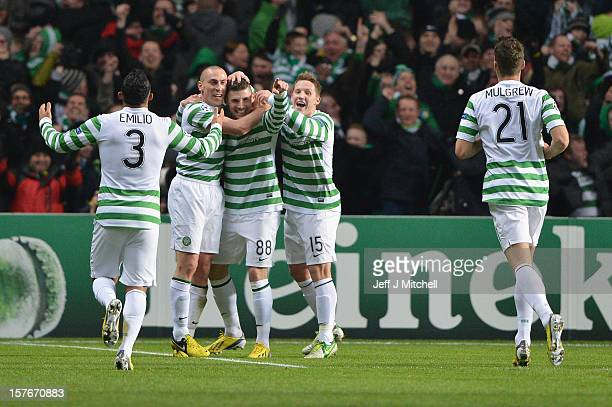 Garry Hooper of Celtic celebrates scoring with Scott Brown and Kris Commons during the UEFA Champions League Group G match between Celtic and FC...