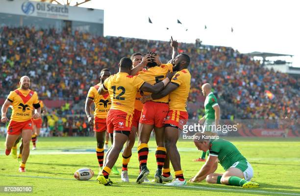 Garry Lo of Papua New Guinea is congratulated by team mates after scoring a try during the 2017 Rugby League World Cup match between Papua New Guinea...