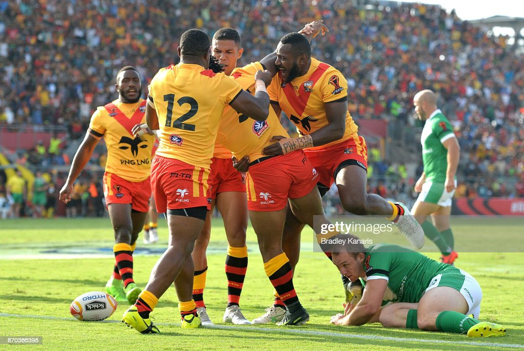 Garry Lo of Papua New Guinea is congratulated by team mates after scoring a try during the 2017 Rugby League World Cup match between Papua New Guinea Kumuls and Ireland on November 5, 2017 in Port Moresby, Papua New Guinea.