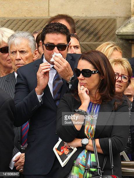 Garry Lyon watches as the coffin leaves after the State Funeral held for former AFL player Jim Stynes at St Paul's Cathedral on March 27 2012 in...