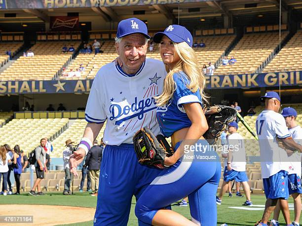 Garry Marshall and Charlotte McKinney attend the Dodgers' Hollywood Stars Night Game at Dodger Stadium on June 6 2015 in Los Angeles California