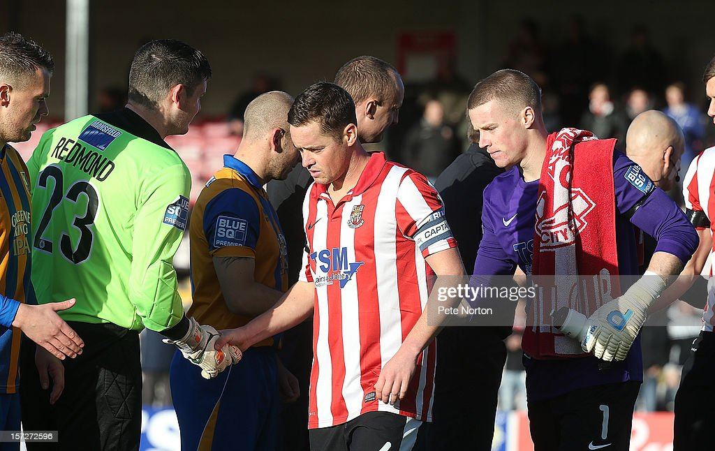 Garry Mills of Lincoln City shakes hands with Shane Redmond of Mansfield Town prior to the FA Cup with Budweiser Second Round match at Sincil Bank Stadium on December 1, 2012 in Lincoln, England.